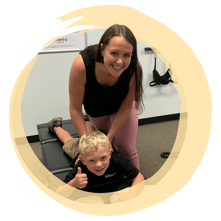 Chiropractor in Ormond Beach FL Jayme Frear with Child Patient